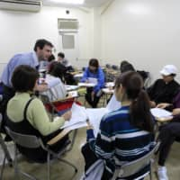 Students participate in a class in the English for Liberal Arts Program. |