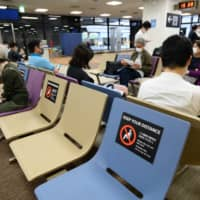 Travelers from among the 159 countries covered by the entry restrictions with higher numbers of infections will be required to meet stricter entry conditions. | BLOOMBERG