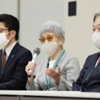 Sakie Yokota (second from right), whose daughter Megumi was abducted by North Korea in 1977 at age 13, speaks at a news conference in Tokyo on Tuesday after meeting with Prime Minister Yoshihide Suga . | KYODO