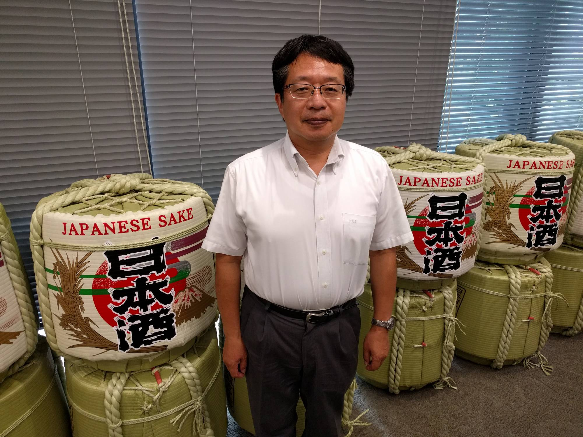 Hitoshi Utsunomiya, director of the Japan Sake and Shochu Makers Association, believes many people in Japan know little about sake because it has 'disappeared from homes.' | ANDREW MCKIRDY
