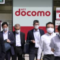 Following a recently announced buyout, NTT Docomo Inc. will become a wholly owned subsidiary of NTT. | BLOOMBERG