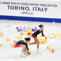 Volunteers remove toy bears and other items from the ice following a performance by Yuzuru Hanyu at the 2019 ISU Grand Prix Final in Turin, Italy, on Dec. 5, 2019. | REUTERS