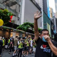 Hong Kong ensures 'stable' holiday with thousands of riot police