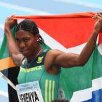 South Africa's Caster Semenya poses with the country's flag after winning the women's 800m of the African Athletics Championships in Asaba, Nigeria, on Aug. 5, 2018. | AFP-JIJI