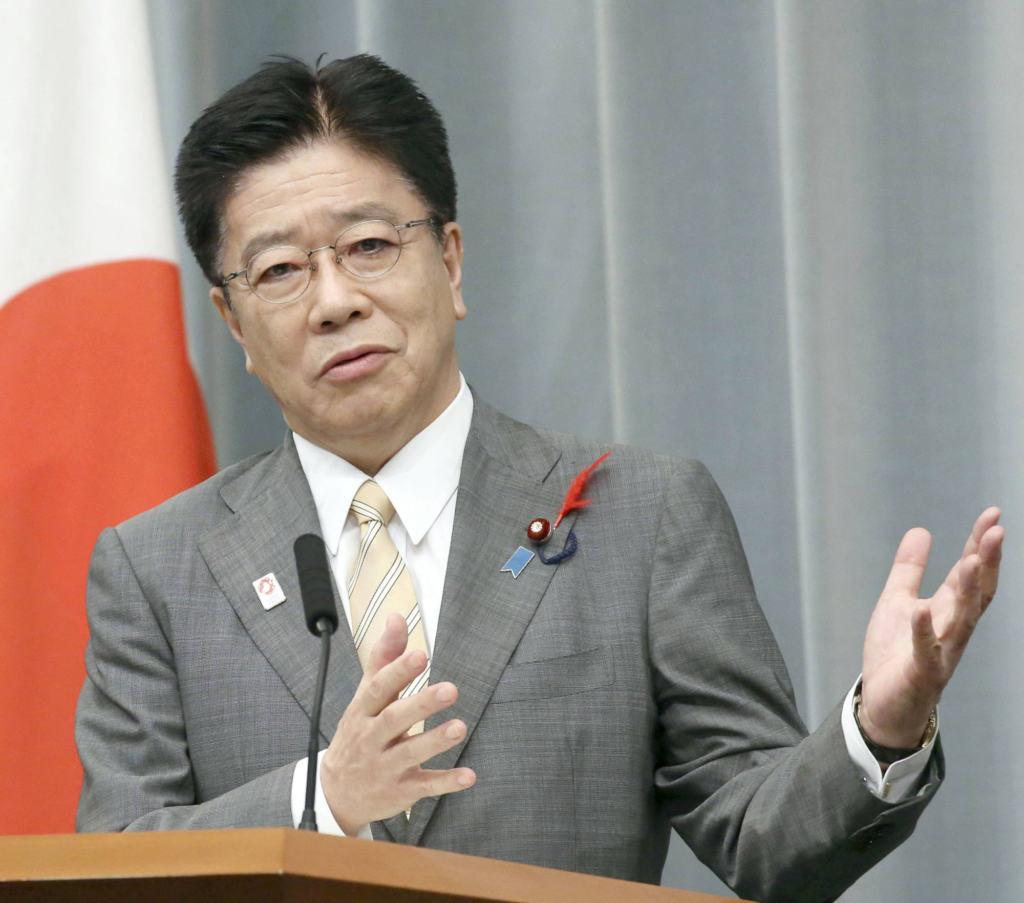 Chief Cabinet Secretary Katsunobu Kato speaks at a news conference at the Prime Minister's Office on Friday. | KYODO