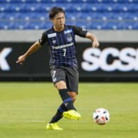 Gamba's Yasuhito Endo passes the ball during a J. League first-division match on July 4 in Suita, Osaka Prefecture. | KYODO