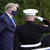 U.S. President Donald Trump arrives at Walter Reed National Military Medical Center in Bethesda, Maryland, on Friday, on Marine One after he tested positive for COVID-19.   AP