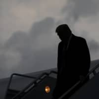 U.S. President Donald Trump descends from Air Force One at Joint Base Andrews in Maryland on Thursday evening after a fundraiser in New Jersey. Trump revealed early Friday morning that he and the first lady, Melania Trump, had tested positive for the coronavirus, throwing the nation's leadership into uncertainty and escalating the crisis posed by a pandemic that has already killed more than 200,000 Americans and devastated the economy.   ERIN SCHAFF / THE NEW YORK TIMES