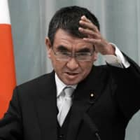 Taro Kono, newly appointed minister in charge of administrative reform, speaks during a news conference at the prime minister's official residence in Tokyo on Sept. 17. | AP