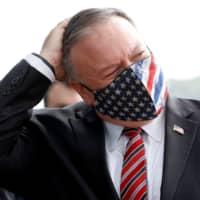 U.S. Secretary of State Mike Pompeo wears a face mask during his visit in Dubrovnik, Croatia, on Friday. | POOL / VIA REUTERS
