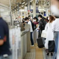 People ride the shinkansen at Tokyo Station on Saturday afternoon. | KYODO