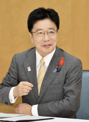 Chief Cabinet Secretary Katsunobu Kato speaks during an interview with media outlets on Friday in Tokyo. | KYODO