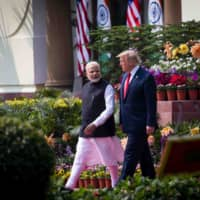 U.S. President Donald Trump and Indian Prime Minister Narendra Modi in New Delhi in February. India's border dispute with China has accelerated its relations with the United States.  | DOUG MILLS / THE NEW YORK TIMES