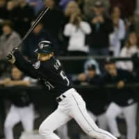Seattle's Ichiro Suzuki of Japan hits a single against the Rangers for his 258th hit of the season, surpassing George Sisler's record, on Oct. 1, 2004, in Seattle. | REUTERS