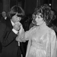 Kenzo Takada kisses the hand of Italian actress Gina Lollobrigida after she awarded him as one of the 10 most elegant men in the world in Rome in 1977. | AP