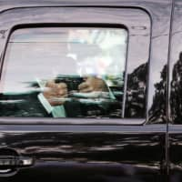 U.S. President Donald Trump gestures to supporters as he rides in the presidential SUV near  Walter Reed National Military Medical Center, where he is being treated for COVID-19, in Bethesda, Maryland, on Sunday.  | REUTERS