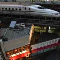 A Shinkansen bullet train travels along an elevated railway track near Yurakucho station in Tokyo. | BLOOMBERG