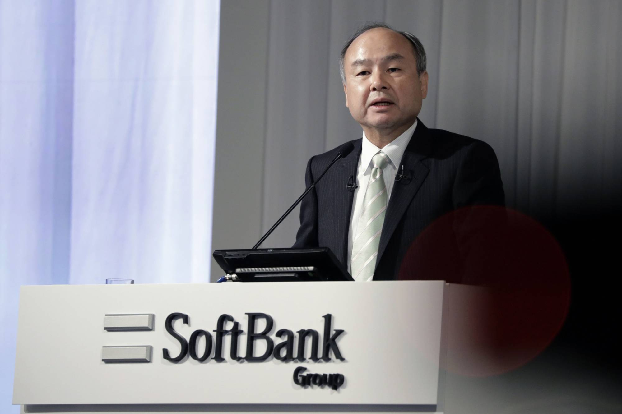 Almost everyone except founder Masayoshi Son at Softbank Group opposes the idea of going private. | BLOOMBERG