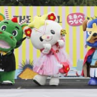 Takata-no-Yumechan (center), the official mascot of Rikuzentakata, Iwate Prefecture, wins Japan's 10th and final mascot competition on Sunday. Yurunakin (right) of Izumisano, Osaka Prefecture, came second, while Tsurugon (left) of Tsurugashima, Saitama Prefecture, was third. | KYODO