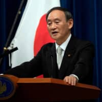 Yoshihide Suga speaks during a news conference in Tokyo on Sept. 16. following his confirmation as Prime Minister in Tokyo. Suga has denied that the rejection of six scholars to the Science Council of Japan is attributed to their criticism of national security legislation approved under then-Prime Minister Shinzo Abe. | POOL / VIA REUTERS