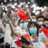 First-year students attend a commencement ceremony at Wuhan University in Wuhan, China, the epicenter of the COVID-19 pandemic, on Sept. 26. | AFP-JIJI