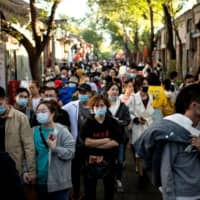 A crowded shopping area in Beijing on Monday  | AFP-JIJI