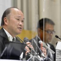Kindai University vice president Hisao Atsumi discusses the use of cannabis by members of the university's soccer team at a news conference on Monday in Osaka. | KYODO