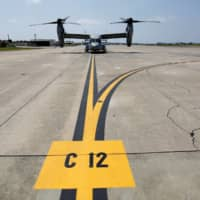 In our defense: A U.S. Marine Corps MV-22 Osprey aircraft is seen at the U.S. Marine Corps' Futenma Air Station in Ginowan on Japan's southernmost island of Okinawa. | REUTERS