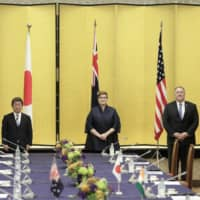 Indian External Affairs Minister Subrahmanyam Jaishankar, Foreign Minister Toshimitsu Motegi, Australian Foreign Minister Marise Payne and U.S. Secretary of State Mike Pompeo pose for a photograph prior to the Quadrilateral Security Dialogue, or 'Quad' ministerial meeting, in Tokyo on Tuesday. | BLOOMBERG