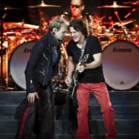 David Lee Roth (left), formerly of the band Van Halen, and Eddie Van Halen perform at Madison Square Garden in 2012.   CHAD BATKA / THE NEW YORK TIMES
