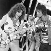 Eddie Van Halen (left) performs 'Beat It' with Michael Jackson in 1984.  | AP