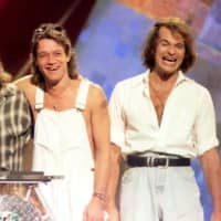 Members of the band Van Halen (from left to right) Alex Van Halen, Michael Anthony and Eddie Van Halen are reunited with former lead singer David Lee Roth (right) at the 1996 MTV Video Music Awards in New York. | REUTERS