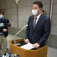 Defense Minister Nobuo Kishi speaks to reporters in Tokyo after holding talks on the phone with U.S. Defense Secretary Mark Esper. | KYODO