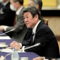 Foreign Minister Toshimitsu Motegi speaks at the 'Quad' meeting in Tokyo on Tuesday. | POOL / VIA AFP-JIJI