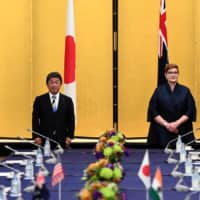 India's Foreign Minister Subrahmanyam Jaishankar, Japan's Foreign Minister Toshimitsu Motegi, Australian Foreign Minister Marise Payne and U.S. Secretary of State Mike Pompeo pose for a picture as they attend a meeting in Tokyo on Tuesday. | POOL / VIA REUTERS