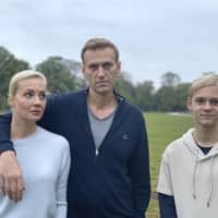 Russian opposition leader Alexei Navalny poses with his wife, Yulia, and their son, Zahar, in an unknown location in Germany.  | INSTAGRAM / @NAVALNY / VIA AP