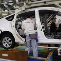 Significant improvements in exports, especially of cars, as well as in shipments of industrial goods such as steel helped lift Japan's economic assessment for August. |  REUTERS