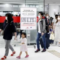 Business travelers and returnees will be exempt from Japan's 14-day quarantine policy, government sources say. | KYODO