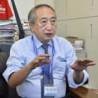 Nobuhiko Okabe, the head of the Kawasaki City Institute for Public Health, speaks during an interview in Kawasaki on Sept. 30. | KYODO