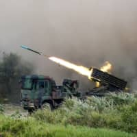 A Thunderbolt 2000 multiple rocket launcher fires munitions during a military exercise in Taichung, Taiwan, in July.