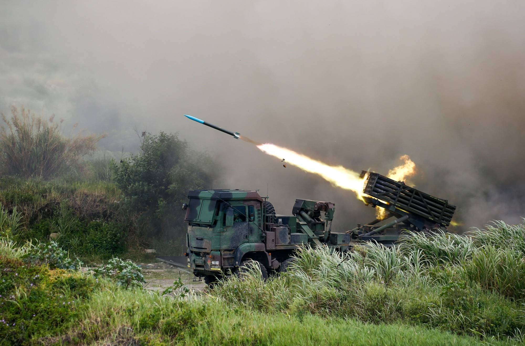 A Thunderbolt 2000 multiple rocket launcher fires munitions during a military exercise in Taichung, Taiwan, in July. | BLOOMBERG