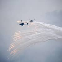 Taiwanese Apache helicopters release flares during a military exercise in Taichung in July.  | BLOOMBERG