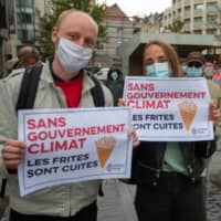 People take part in a demonstration calling for action on climate change in Brussels on Sept. 25.    AFP-JIJI