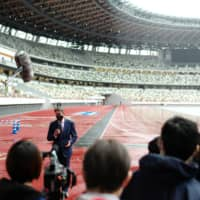World Athletics President Sebastian Coe speaks to members of the media during a visit to the National Stadium in Tokyo's Shibuya Ward on Thursday. | RYUSEI TAKAHASHI