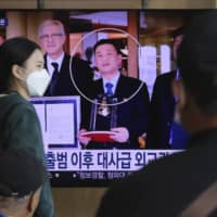 A news program broadcast at Seoul Railway Station on Wednesday shows an image of Jo Song Gil, North Korea's former ambassador to Italy. Jo, who had vanished in Italy in late 2018, currently lives in South Korea under government protection, a lawmaker said Wednesday.  | AP
