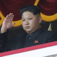North Korean leader Kim Jong Un watches a military parade during celebrations to mark the 70th anniversary of North Korea's ruling Workers' Party in Pyongyang in October 2015.   AP