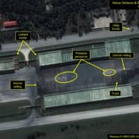 An annotated satellite image shows a close-up of the vehicle storage compound at the Mirim Parade Training Ground on Oct. 6 ahead of the 75th anniversary of North Korea's ruling Workers' Party in Pyongyang.   AIRBUS DEFENSE & SPACE / 38 NORTH / PLEIADES © CNES 2020/ VIA REUTERS