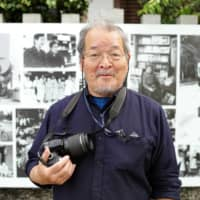 Capturing the past: Fusayoshi Kai, whose photographs are on display along the Kamo River, has been documenting life along the river for more than four decades. | RYUSEI TAKAHASHI