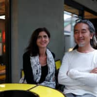 Teamwork: Lucille Reyboz (left) and Yusuke Nakanishi, co-founders and co-directors of Kyotographie, sit outside Delta, the art festival's first-ever permanent space. | RYUSEI TAKAHASHI