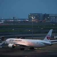 A Japan Airlines Co. aircraft at Haneda Airport in Tokyo in July | BLOOMBERG
